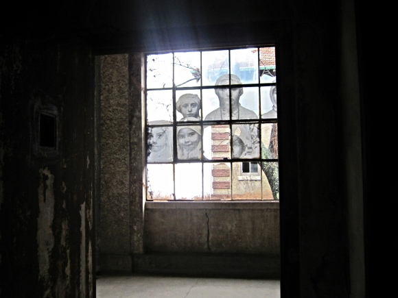 JR's installation in the abandoned Ellis Island hospital